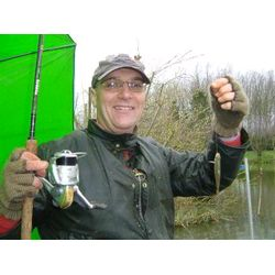 Angling Training - Phil Hacking with one of the smaller roach from the session